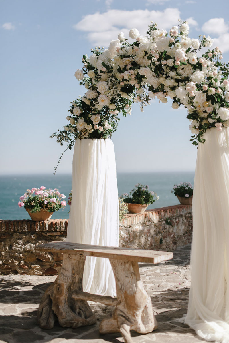 White flowers arch with fabric wedding Malaga Castillo de Santa Catalina