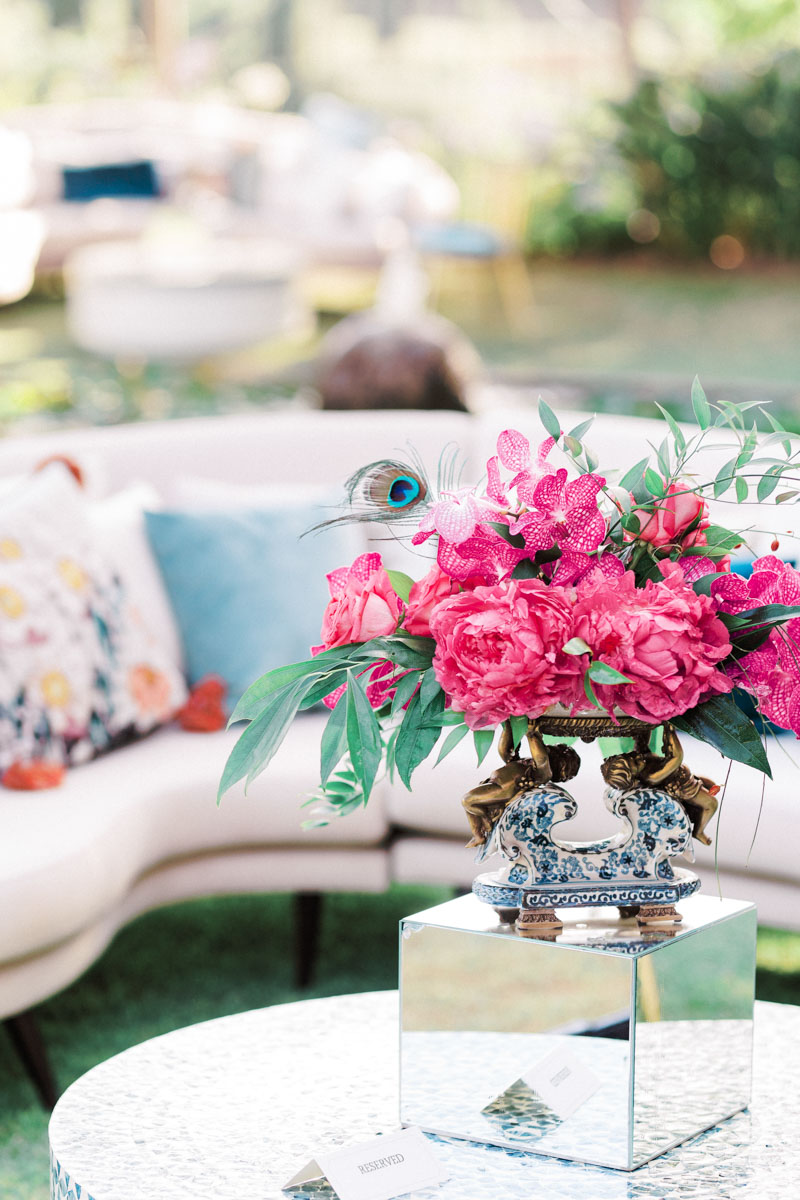 Bright pink flower arrangements for chill out area wedding Anantara Villa Padierna