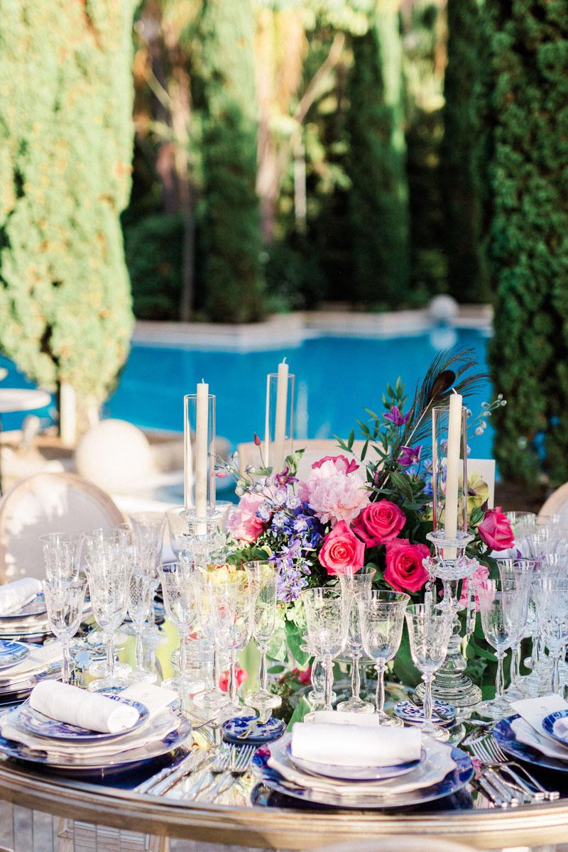 Blue tableware crystal glasses colourful flower arrangements wedding Anantara Villa Padierna