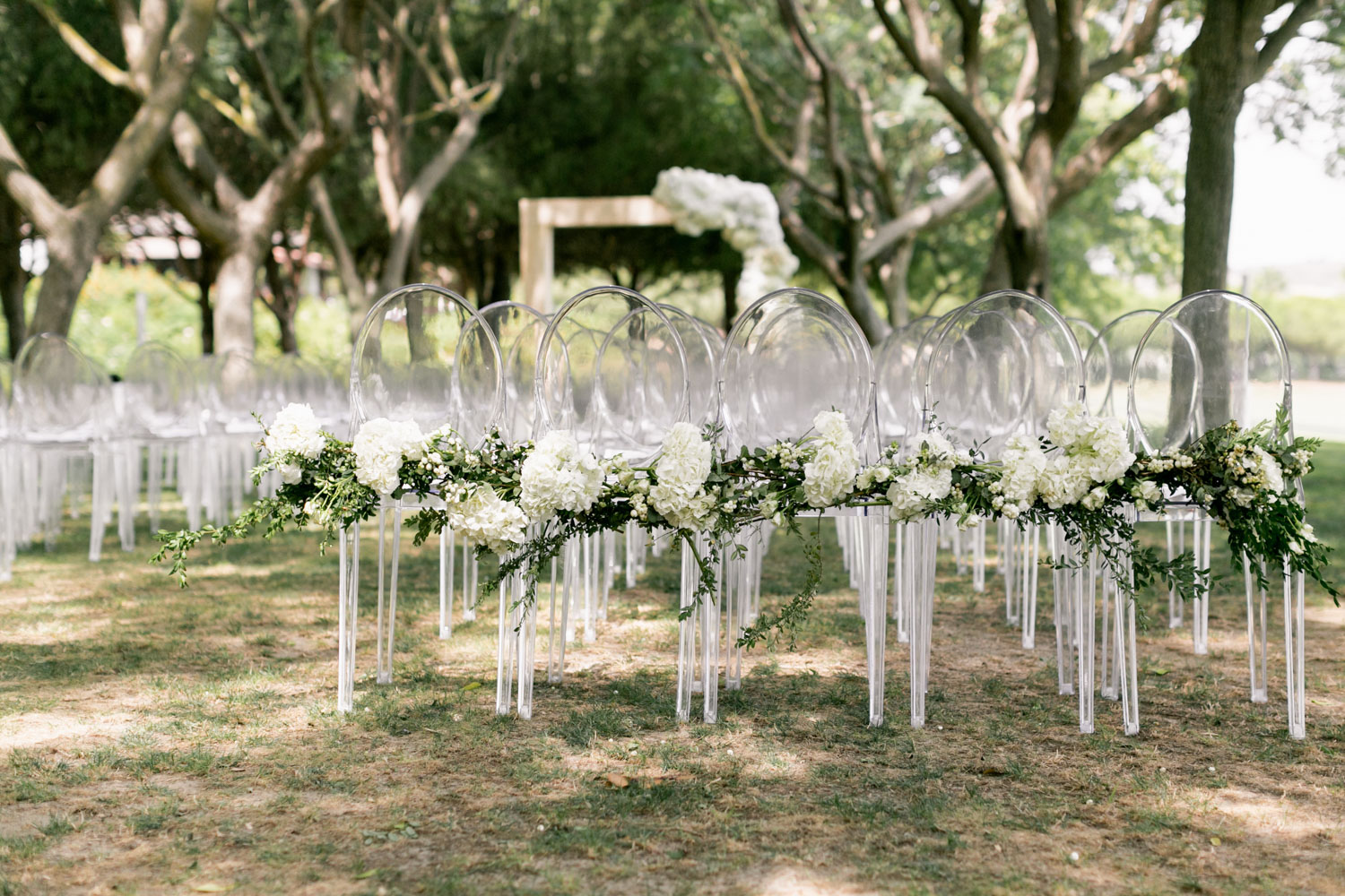 Perspex chair with white flowers wedding Sotogrande Cancha II