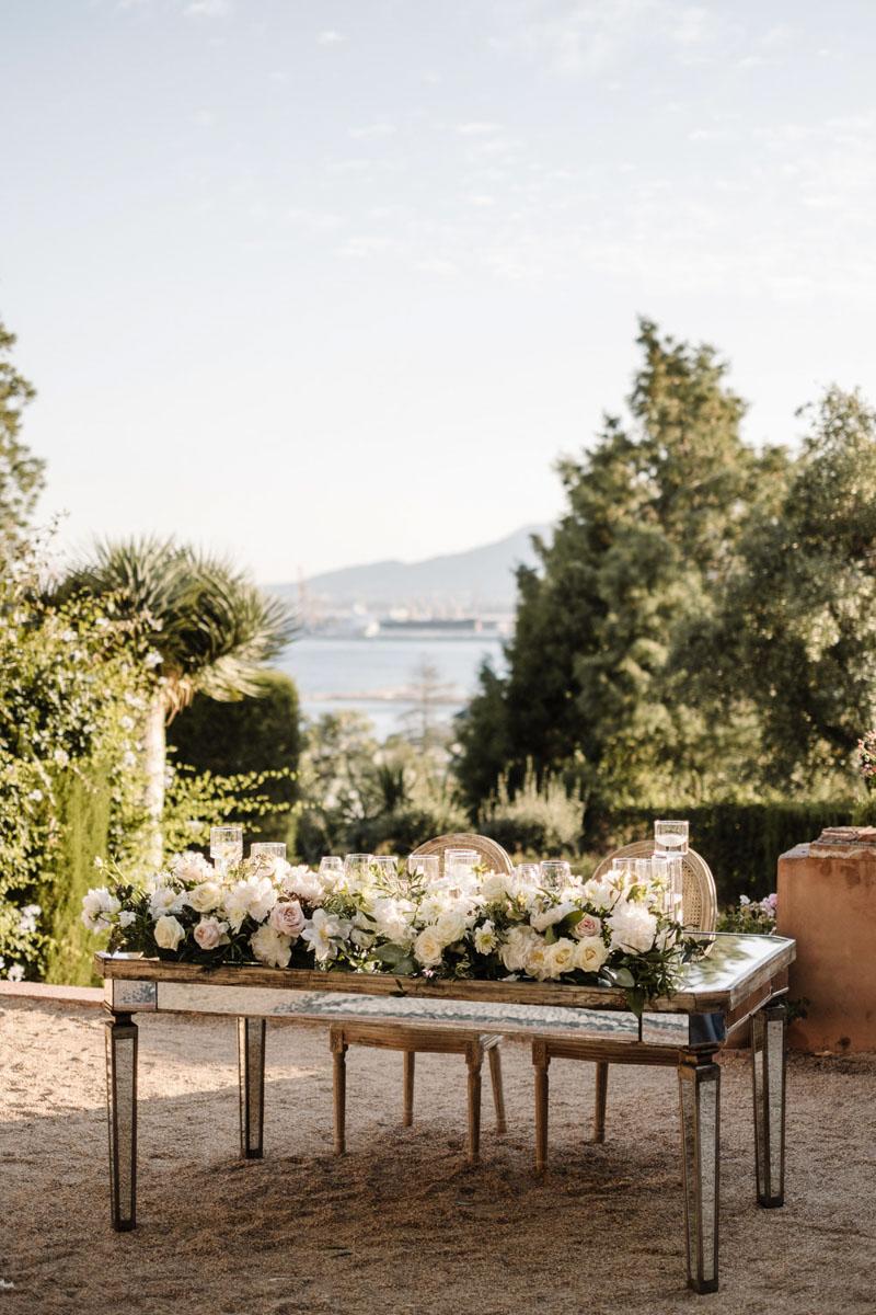 Mirror top table flower garland wedding Malaga Castillo de Santa Catalina