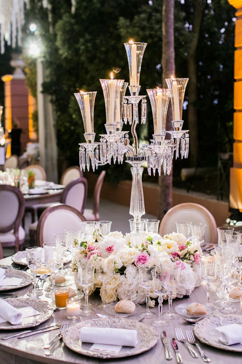Crystal candelabra with candles and flowers wedding Marbella Anantara Villa Padierna