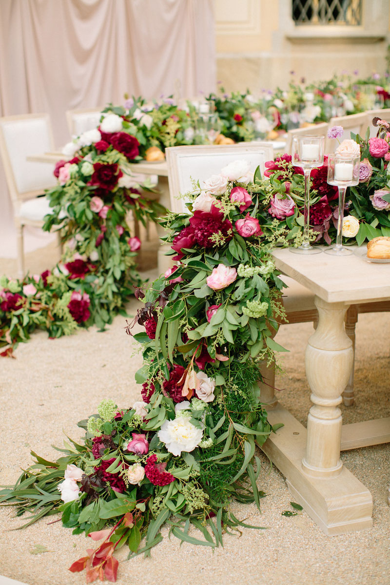 Table set up with flower garland for wedding Barcelona