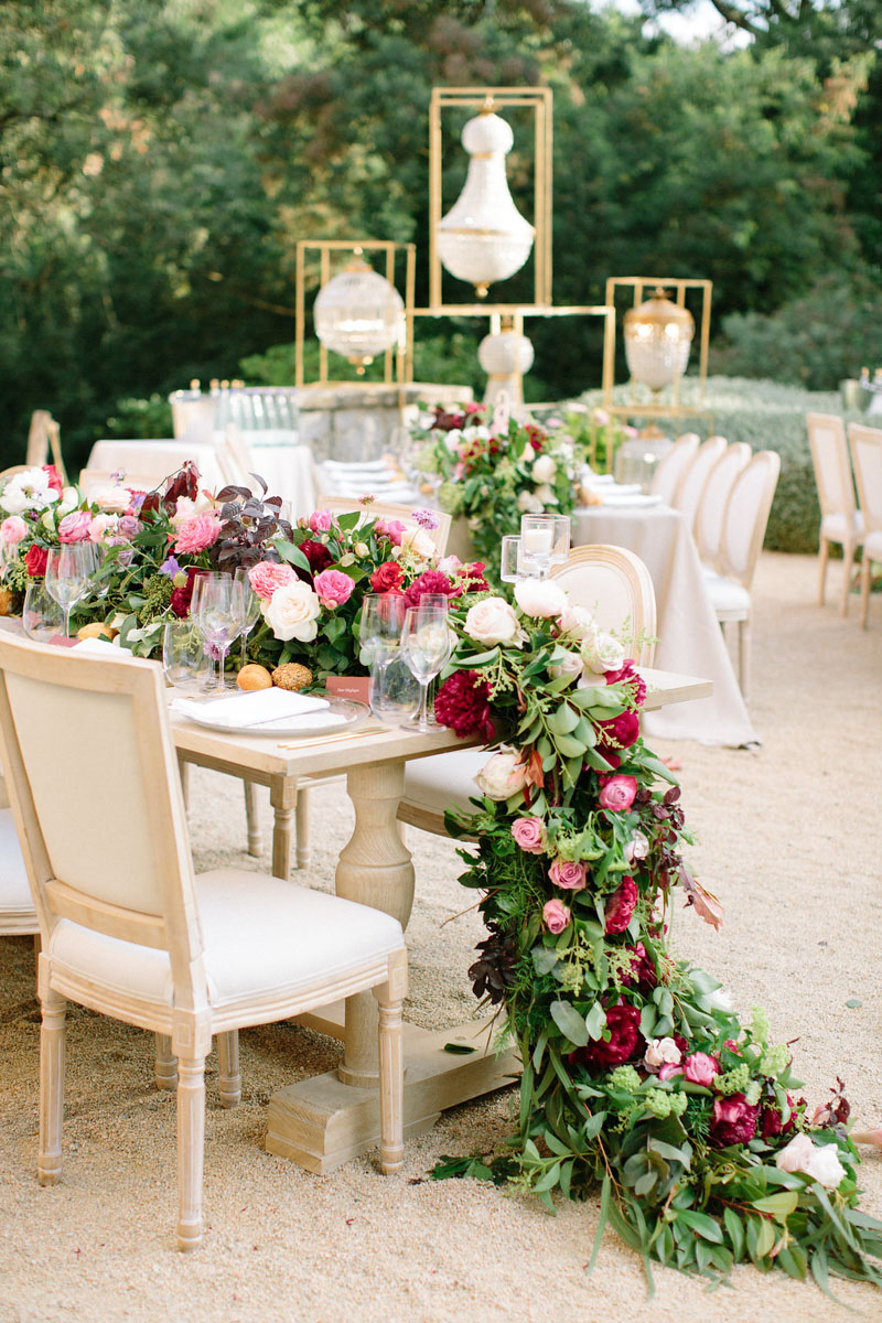 Table set up with flower garland crystal lamps for wedding Barcelona