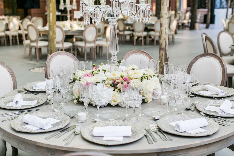 flower arrangement round wood table Marbella wedding Anantara Villa Padierna