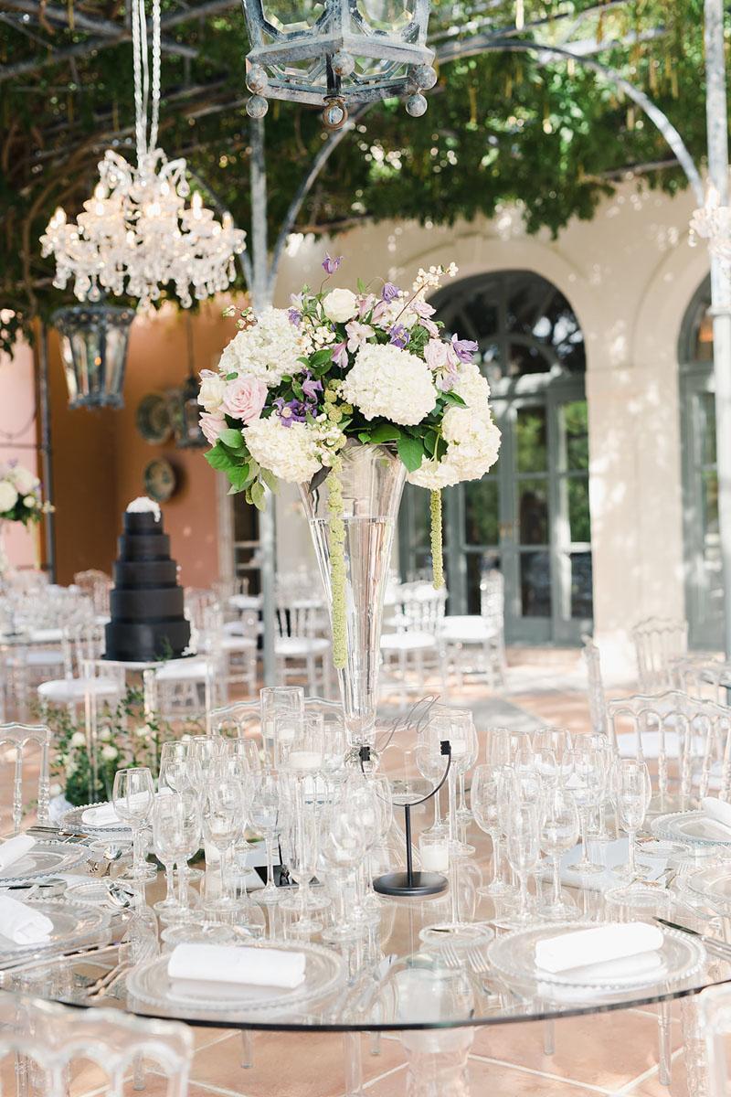 Centerpiece wedding on perspex table Anantara Villa Padierna