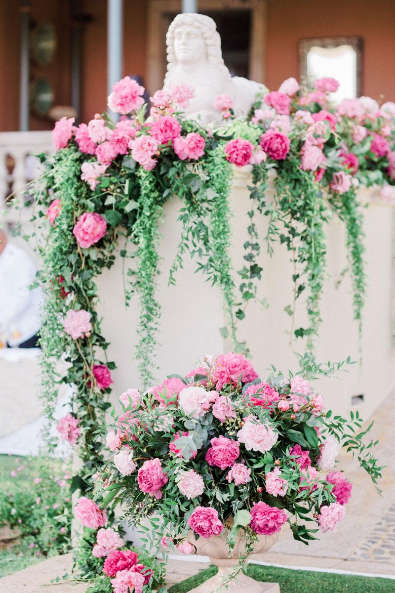 Bright pink and greenery flower decoration wedding Anantara Villa Padierna