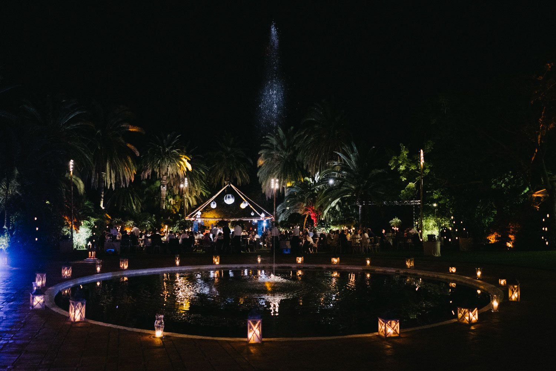 candles around fountain and table set up wedding Marbella Finca La Concepcion