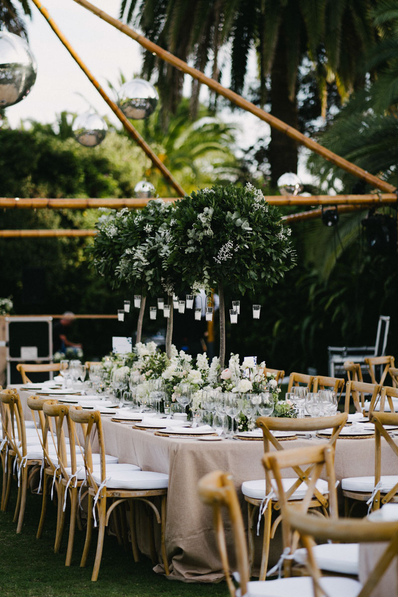 Long table with sandy color table cloth and tall arrangements Finca La Concepcion