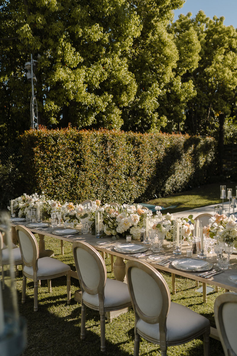 Wood table with white flowers and candles Marbella wedding Marbella Club Hotel