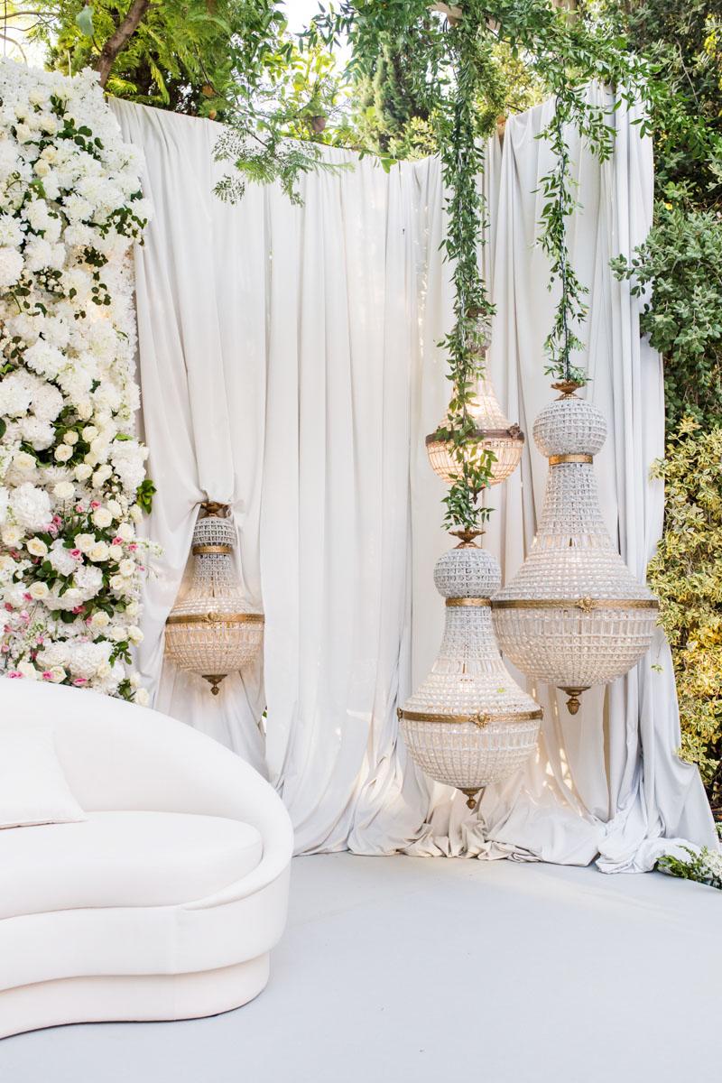 Crystal lamps with fabric backdrop Arab wedding Kosha Anantara Villa Padierna