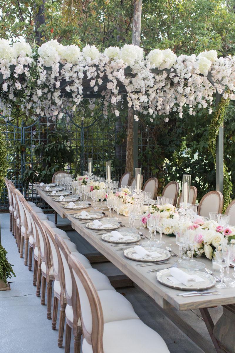 Long wood table silver charger plates wood wisteria and flower roof wedding Marbella Anantara Villa Padierna