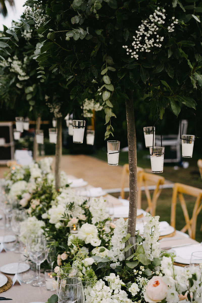 Candles hanging from a table arrangement