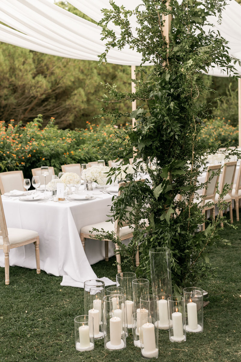 Sails over table wedding long table white flowers cylinders candles Cancha II Sotogrande