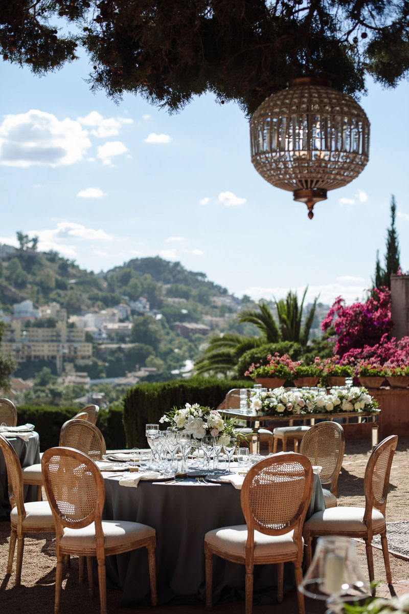 Blue table cloth lamp Louis XVI chairs wedding Castillo de Santa Catalina Malaga