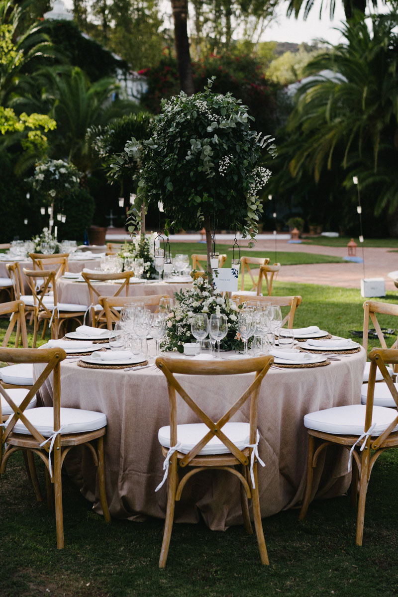 Tall arrangement with greenery and candles wedding Finca La Concepcion