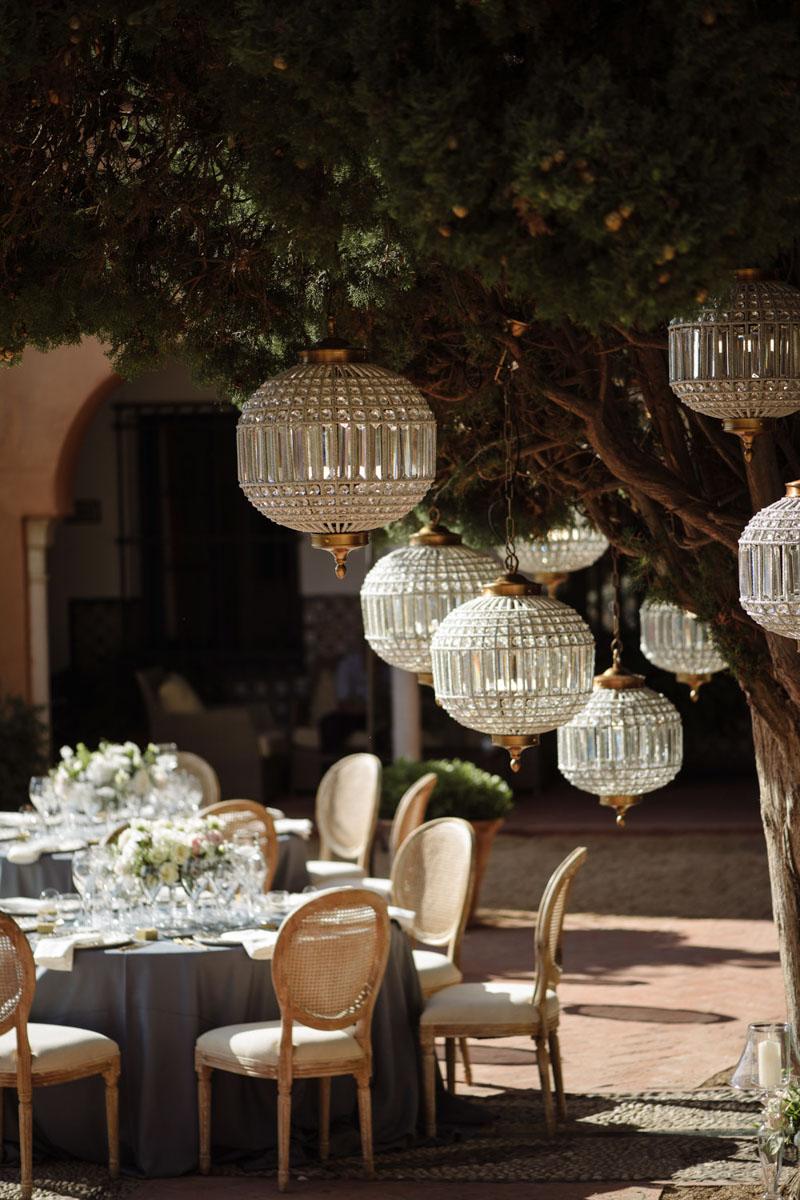 Blue table cloth lamps Louis XVI chairs wedding Castillo de Santa Catalina Malaga