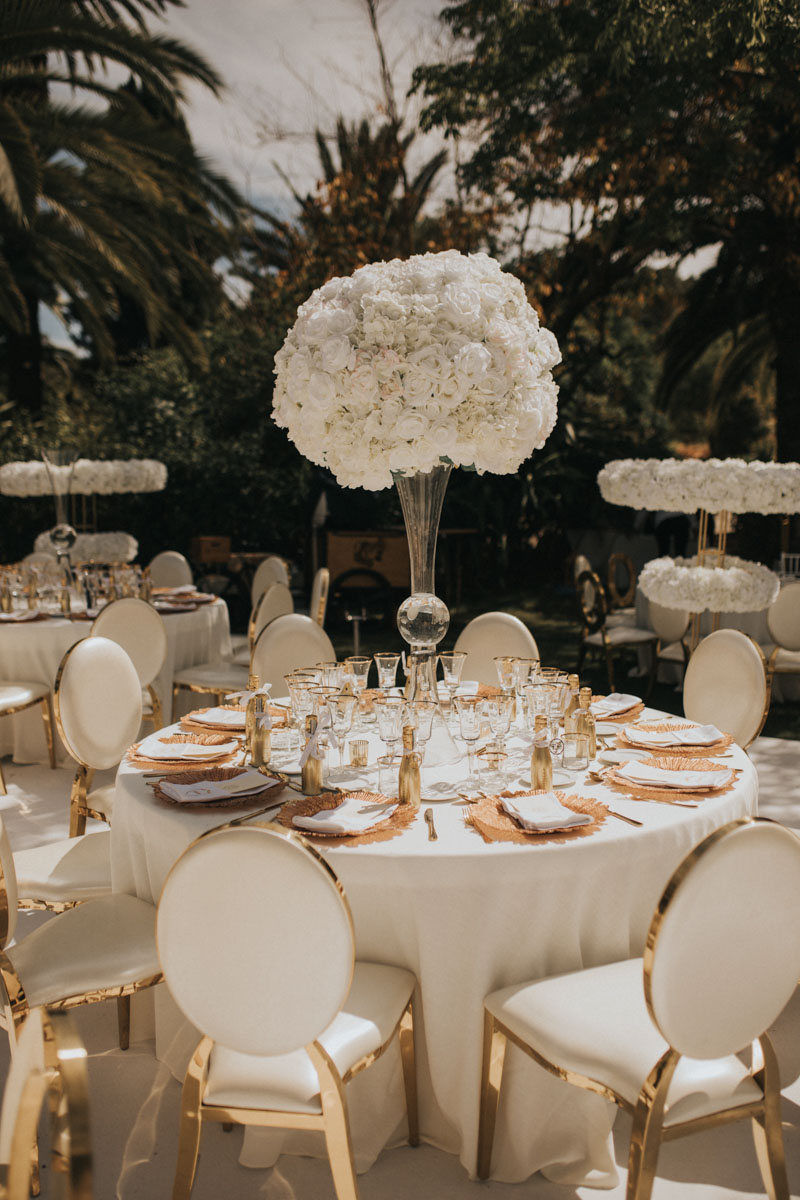 White center piece with medallion gold chairs