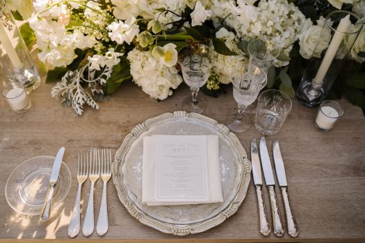 Silver Florentine charger plate, engraved glasses, silver cutlery and white flowers Marbella Club Hotel