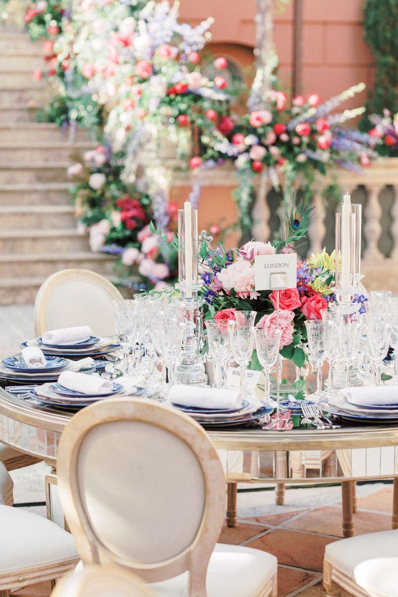 Mirror table Louis XVI chairs bright colour flower arrangements Anantara Villa Padierna